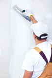 Contractor plasterer. Mature contractor  plasterer working indoors Royalty Free Stock Photo