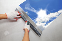 Contractor Plasterer.  Sun and sky Royalty Free Stock Image