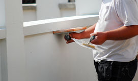 Contractor plasterer working outdoors Royalty Free Stock Image