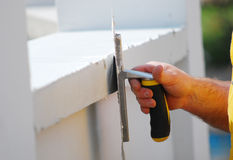 Contractor plasterer working outdoors Stock Images