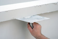 Contractor plasterer working outdoors Stock Image