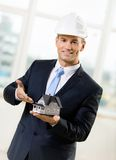 Contractor pointing at model house Stock Photos