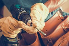 Contractor with Power Tool. Closeup Photo. Cordless Driller in Hands of Caucasian Construction Worker Stock Image