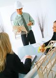 Contractor Presenting Project To Businesswoman Stock Image