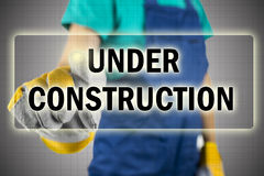 Contractor pressing Under construction button Royalty Free Stock Photo