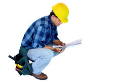 Contractor Reading Blueprints Royalty Free Stock Image