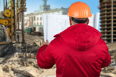 Contractor reading plans royalty free stock image