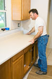 Contractor Remodeling Kitchen Royalty Free Stock Photography