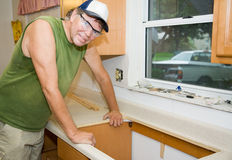 Contractor Remodeling Kitchen Stock Photo