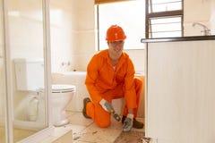 Free Contractor Removing Floor Tiles Stock Photos - 60825443