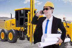 Contractor and the road construction machine Stock Image