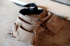 Contractor's Tool Belt. On wooden floor royalty free stock photos