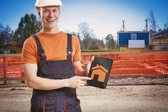Contractor showing digital tablet Stock Photography