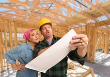 Contractor Showing Plans to Woman On Site Inside New Home Constr Stock Photography