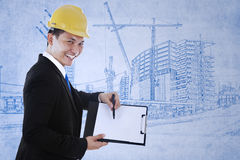 Contractor shows blank paper Royalty Free Stock Images
