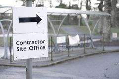 Contractor site office construction sign direction arrow. Uk royalty free stock photography