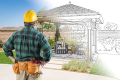 Contractor Standing Looking At Patio Pergola Design Drawing and. Photo Combination Royalty Free Stock Photography