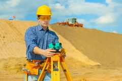 Contractor with theodolite Royalty Free Stock Images