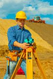 A contractor with theodolite Royalty Free Stock Photo