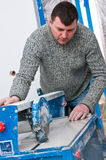 Contractor with tile cutting machine royalty free stock images