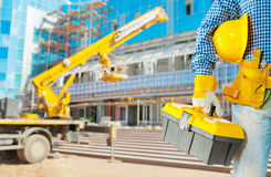 Contractor with tools on construction site Stock Photo