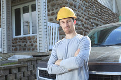 Contractor with is truck. A contractor with is truck and a cross arm royalty free stock photography