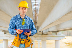 A contractor under the bridge under construction Stock Photography
