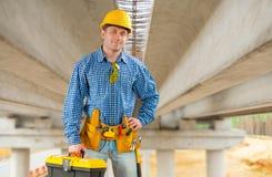 Contractor under the bridge Stock Images