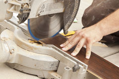 Contractor Using Circular Saw Cutting of New Laminate Flooring. Renovation Royalty Free Stock Photos