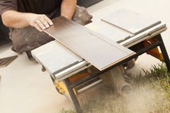 Contractor Using Circular Saw Cutting Of New Laminate Flooring Royalty Free Stock Image
