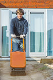 Contractor with  a vibratory plate compactor Royalty Free Stock Photography
