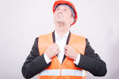 Contractor wearing hardhat arranging his jacket Royalty Free Stock Photography