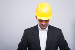 Contractor wearing hardhat arranging jacket Stock Images