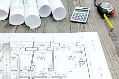 Contractor work tools with floor plan on gray wooden boards Stock Photography