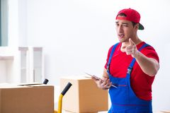The contractor worker moving boxes during office move. Contractor worker moving boxes during office move stock photo