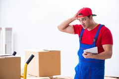 The contractor worker moving boxes during office move. Contractor worker moving boxes during office move stock photos