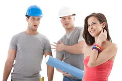 Contractor workers staring at pretty girl Royalty Free Stock Photo
