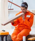 Contractor working on laminate wooden floor stock photography