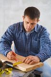Contractor working with pencil and wooden board Stock Photography
