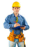Contractor writing in clipboard Stock Photography