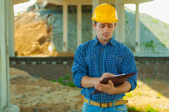 Contractor writing in clipboard Stock Photos