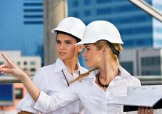 Contractors. In a front of building site royalty free stock images