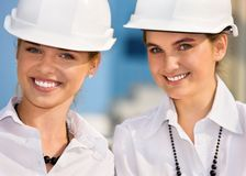Contractors. In a front of building site stock photography