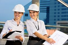Contractors. In a front of building site stock images