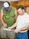 Contractors Check Plans Royalty Free Stock Photos