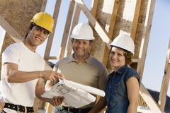 Contractors Discussing At Construction Site Royalty Free Stock Images