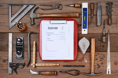 Contractors Estimate Form Surrounded By Tools Royalty Free Stock Photo