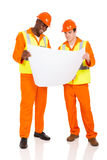 Contractors holding blueprint. Professional young contractors holding blueprint Stock Photo
