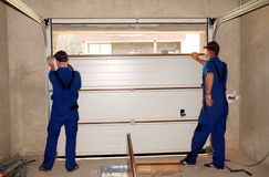 Contractors Installing, Repair, Insulating Garage Door. Garage door seal, garage door replacement, garage door repair. Contractors Installing, Insulating Garage stock photos