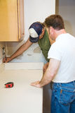 Contractors and Kitchen Counter Royalty Free Stock Photography